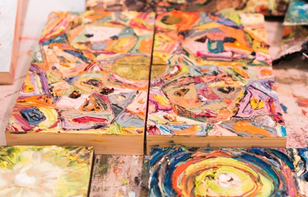 close up to artwork on a table, swirls of paint on wood blocks